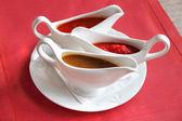 Three sauces - adjika, tkemali and satsebeli — Stock Photo
