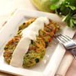 Zucchini pancakes with green onions and sour cream - Stock Photo