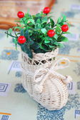 Home decorative artificial plant in a wicker boot — Foto Stock