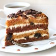 Stock Photo: Cake with sour cream, prunes and walnuts