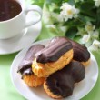 Eclairs with cream in chocolate coating — Stock Photo