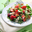 Salad with arugula, strawberries, goat cheese and walnuts — Stock Photo #27164671