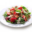 Salad with arugula, strawberries, goat cheese and walnuts — Stock Photo #33224987