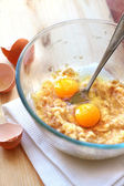 Mix of banana and eggs in a glass bowl — Stock Photo