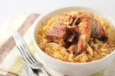 Pork ribs baked with sauerkraut — Stock Photo
