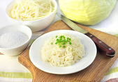 Sauerkraut and ingredients for making it — Stock Photo