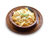 Penne with chicken breast and cheese on a clay bowl — Stock Photo