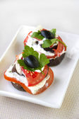 Aubergine appetizer with fresh tomato and cream cheese  — Stock Photo