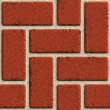 Vector seamless brick wall made of red bricks — Vector de stock