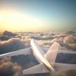 Airplane flying above clouds — Stock Photo