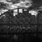 Bridge skyline near night city — Stock Photo