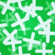 Stock Photo: Crosses Green Background