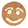 Round of Rye Bread with pictured smile - Stock Photo