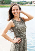 Nice young woman near a river — Stock Photo