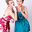 Two beautiful girls in a vintage dress telling tales — Stockfoto
