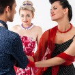 Girls in vintage dress seducing gay in presence aggravated girlf — Stock Photo #35555809