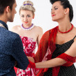 Girls in vintage dress seducing gay in presence aggravated girlf — Stock Photo