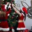 Nice Snow Maidens dress up New Year's tree — Stock Photo #38011465