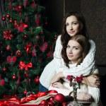 Beautiful girls in woolen sweaters near — Stock Photo #38011559