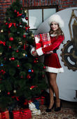 Beautiful Snow Maiden with gift — Stock Photo