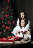 Beautiful girls in woolen sweaters near — Stock Photo