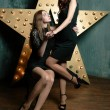 Foto Stock: Beautiful stylish girls cuddling