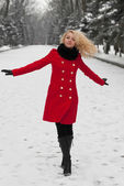 Pretty girl is dancing in the snow — Stock Photo
