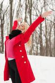 Beautiful girl is happy in winter — Stock Photo