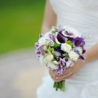 Wedding bouquet of purple and white flowers — Stock Photo