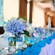 Stock Photo: Wedding tables set for fine dining or another catered event