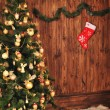 Christmas fir tree with decoration on a wooden board — Stok fotoğraf