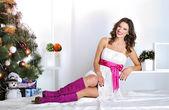 Beautiful happy woman near Christmas tree — Stock Photo
