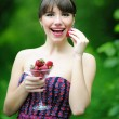 Beautiful brunette girl with strawberry — Stock Photo