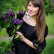Girl with lilac in the park - Photo