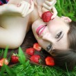 Beautiful brunette girl with strawberry - Photo