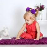 Smiling little girl and white rabbit — Stock Photo