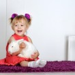 Smiling little girl and white rabbit — Stock Photo #18743651