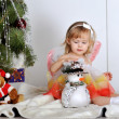 Little girl at a Christmas fir-tree — Stok fotoğraf