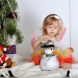 Little girl at a Christmas fir-tree — ストック写真 #18743667