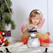 Little girl at a Christmas fir-tree — Stock Photo