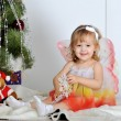 Little girl at a Christmas fir-tree — Stock Photo #18743671