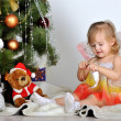Little girl at a Christmas fir-tree — Stock Photo #18743675