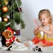 Little girl at a Christmas fir-tree — Stock fotografie
