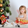 Little girl at a Christmas fir-tree — Stock Photo #18743679