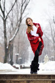 Winter blonde woman portrait. Beautiful fashion model girl in bright scarf — Stock Photo