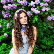 Stock Photo: Beautiful girl with a flower lilac