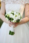 Wedding bouquet in hands of the bride — Stock Photo