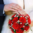 Stock Photo: Hands and rings on wedding bouquet