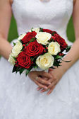 Wedding bouquet of red and white flowers — Stock Photo