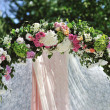 Stock Photo: Wedding Arch with flowers on grass
